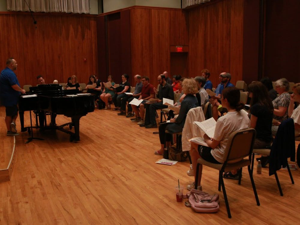 Alan Alder, music instructor and director of University Singers, leads a practice session of the summer chorus alongside Peter Douglas on the piano June 24, 2019, at Hahn Recital Hall. The summer chorus will perform at a free concert open to the public 7:30 p.m. July 16 at Sursa Performance Hall. Rohith Rao, DN