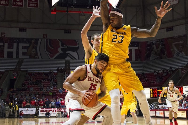 Guard Franko House pushes his way for a two-point lay up against Toledo forward Steve Taylor Jr. on Jan. 31 in Worthen Arena. Ball State defeated Toledo 81-80. Grace Hollars // DN File