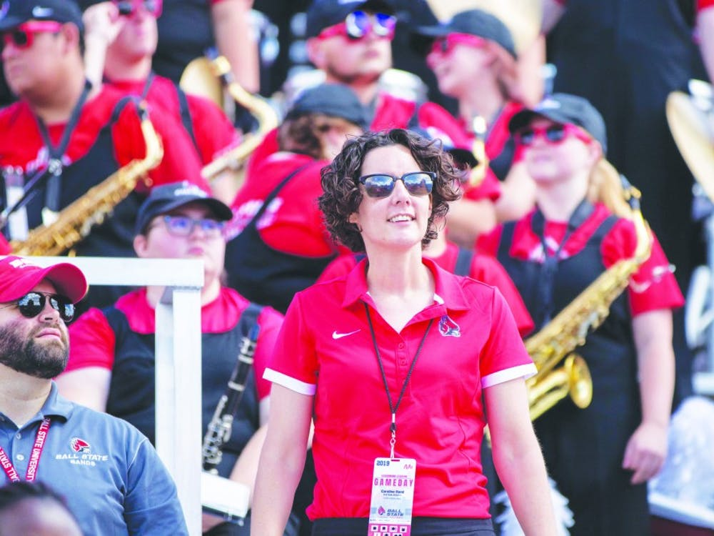 Caroline Hand, director of the Pride of Mid-America (POMA) Marching Band, watches the jumbotron, Sept. 7, 2019, at Scheumann Stadium. Hand is the first female director of POMA at Ball State. Jacob Musselman, DN