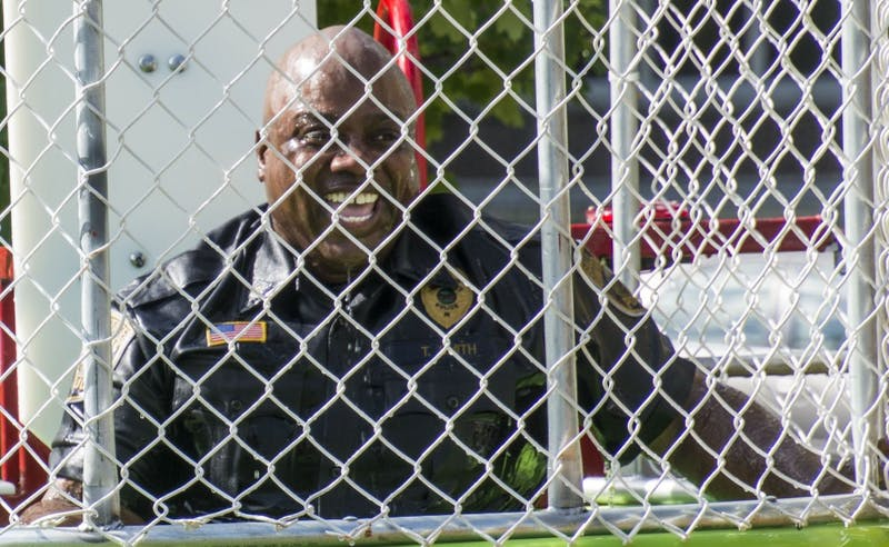 Lt. Terrell Smith of the Ball State University Police Department gets dunked by a student at the Dunk-a-Cop event on Aug. 25, 2016 at the Scramble Light. The event donated all proceeds to Riley Hospital for Children. Samantha Brammer // DN