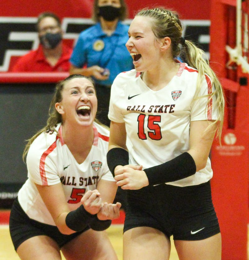 Freshman setter Megan Wielonski and junior middle blocker Marie Plitt celebrate a successful block by Wielonski against Northern Kentucky at Worthen Arena Sept. 17. Ball State had two challenges in the last set turned in its favor, one being the game-winning point. Jacy Bradley, DN