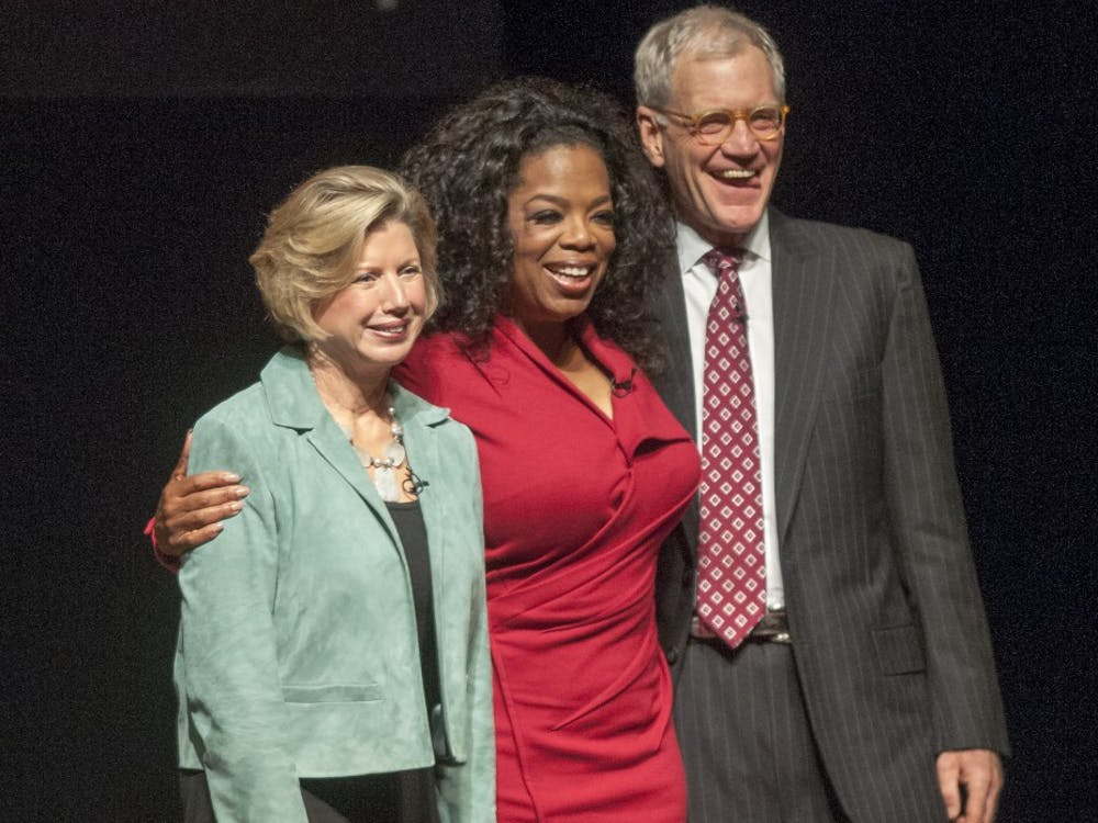 "Ball State President Jo Ann Gora poses with Oprah Winfrey and David Letterman for ""Dave + Oprah"" at John R. Emen's Auditorium on Nov. 26. Gora announced in an email she will retire in June, 2014. DN FILE PHOTO BOBBY ELLIS"