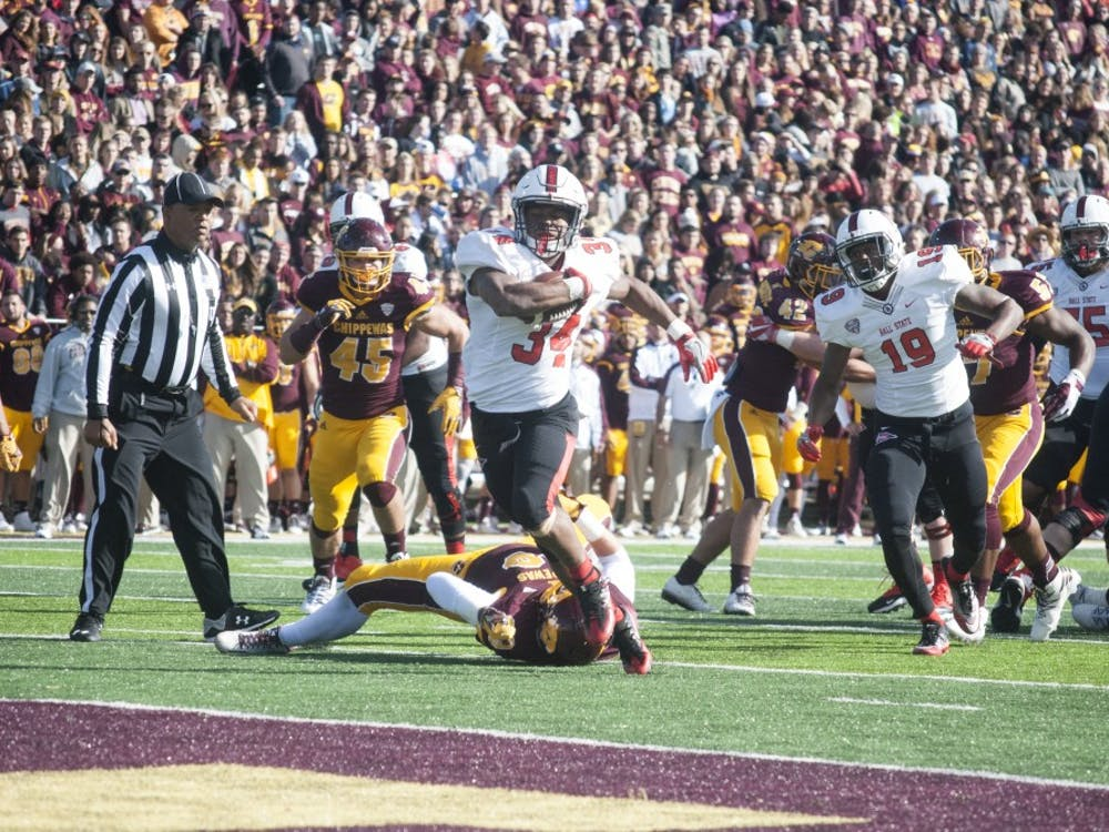 Sophomore Ball State running back James Gilbert scores his first touchdown of the day against Central Michigan. He finished with 141 rushing yards and 2 touchdowns in the 24-21 loss. DN//Colin Grylls