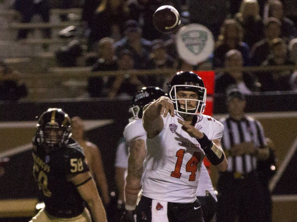 Senior quarterback Jack Milas throws a pass during Ball State's game against Western Michigan on Sept. 30, 2017. Milas finished the game 22-for-40 with 170 passing yards and an interception. Robby General, DN