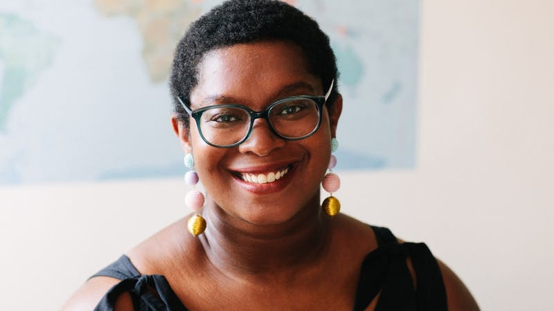 """Ashley C. Ford poses for a headshot wearing colorful, dangling earrings. Ford's memoir, """"Somebody's Daughter,"""" was labeled by Oprah Winfrey as """"An Oprah Book"""" and made part of Winfrey's book club. Ashley C. Ford, Photo Provided"""