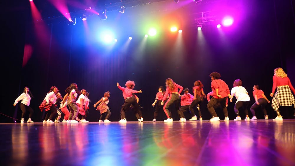 The Outlet team dances during their performance at Homecoming Week's Air Jam event held on Oct. 21 at Emens Auditorium. Outlet took home both overall and independent winner at the event. Eli Houser, DN