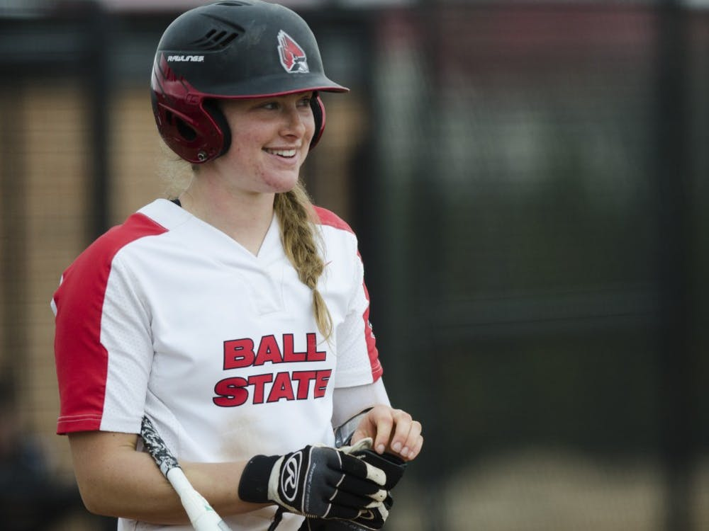 Sophomore catcher Olivia Huffman smiles before her turn at bat during the second game of the double-header against Northern Illinois on April 4 at the Softball Field at the First Merchants Ballpark Complex. Huffman hit a home run during the first game of the double-header. Emma Rogers // DN