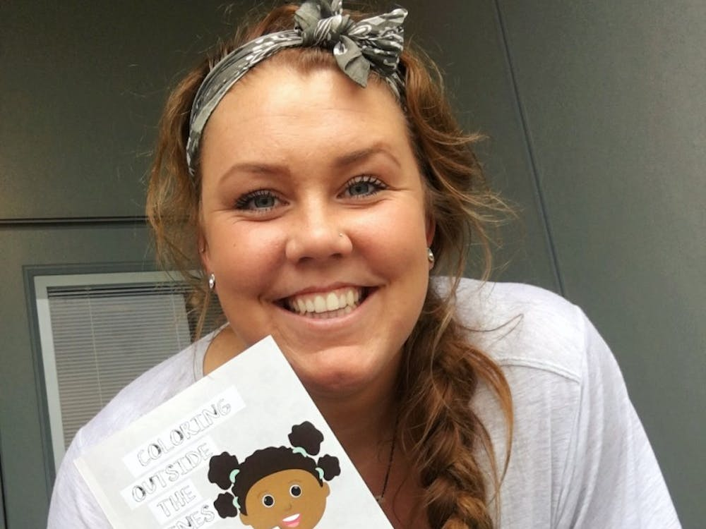 """Graduate student Kelly Hopkins illustrates children's books as a side job. Hopkins teamed up with her formerhigh school vice principal,Jacquelyn Thomas-Miller, to write and illustrate their first picture book,""""Coloring Outside the Lines."""" Kelly Hopkins // Photo Provided"""