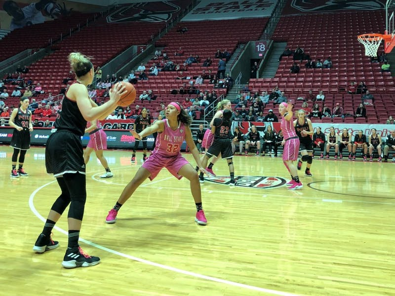 Ball State sophomore forward Oshlynn Brown defends a Northern Illinois player Saturday, Feb. 9, in John E. Worthen Arena. The Cardinals fell to the Huskies, 93-83. Gabi Glass, DN