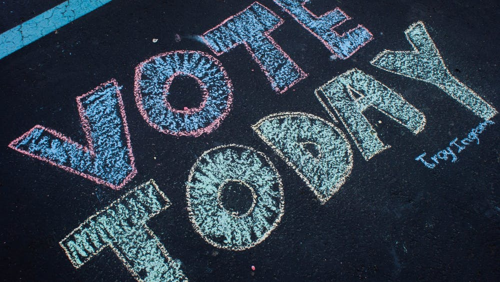 """A message written with chalk May 7, 2019, in the parking lot outside North Side Church of God in Muncie reads """"Vote Today."""" Primary elections are being held June 2, 2020, in Indiana. Blake Chapman, DN"""