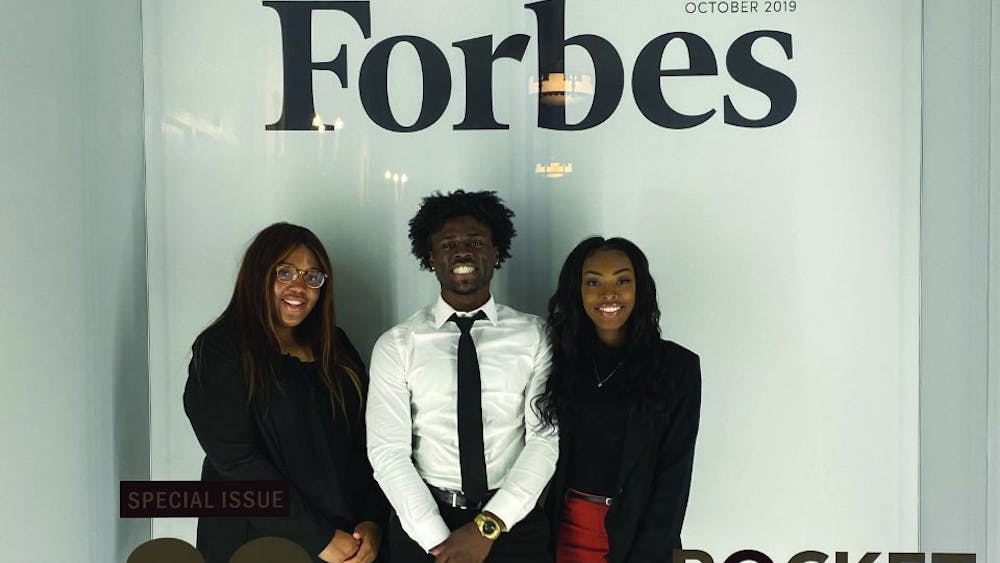 Senior Kaylah Bell (left), junior Aric Fulton Jr. (middle) and senior Tazia Williams (right) attend the Forbes Under 30 Summit Oct. 27-30 in Detroit. Bell, Fulton and Williams were three of 1,000 students selected to receive a scholarship which paid for the fee to attend the conference. Aric Fulton, Photo Provided
