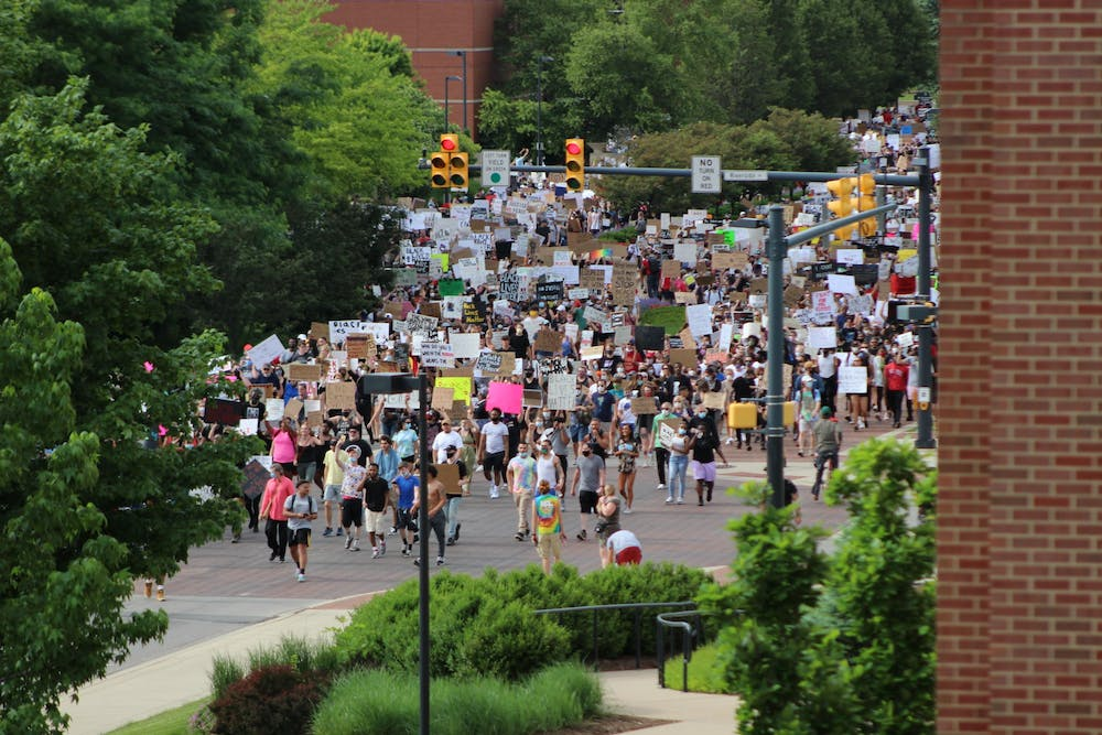 <p>Protesters march through the Scramble Light June 4, 2020, at the intersection of Riverside and McKinley Avenues. Ball State students, faculty, staff and University Police Department officers as well as community members marched in response to the death of George Floyd. <strong>Bailey Cline, DN</strong></p>