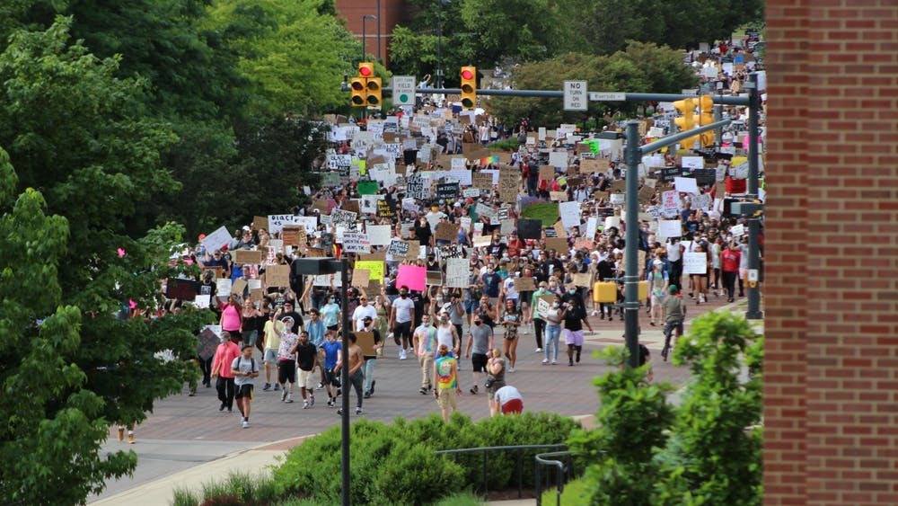 Protesters march through the Scramble Light June 4, 2020, at the intersection of Riverside and McKinley Avenues. Ball State students, faculty, staff and University Police Department officers as well as community members marched in response to the death of George Floyd. Bailey Cline, DN