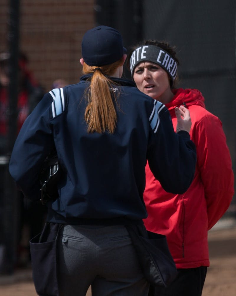Head Coach Megan Ciolli Bartlett talks with an umpire after a call in the fifth inning during the Cardinals' game against Kent State April 7 at the Softball Field at First Merchants Ballpark Complex. Eric Pritchett, DN
