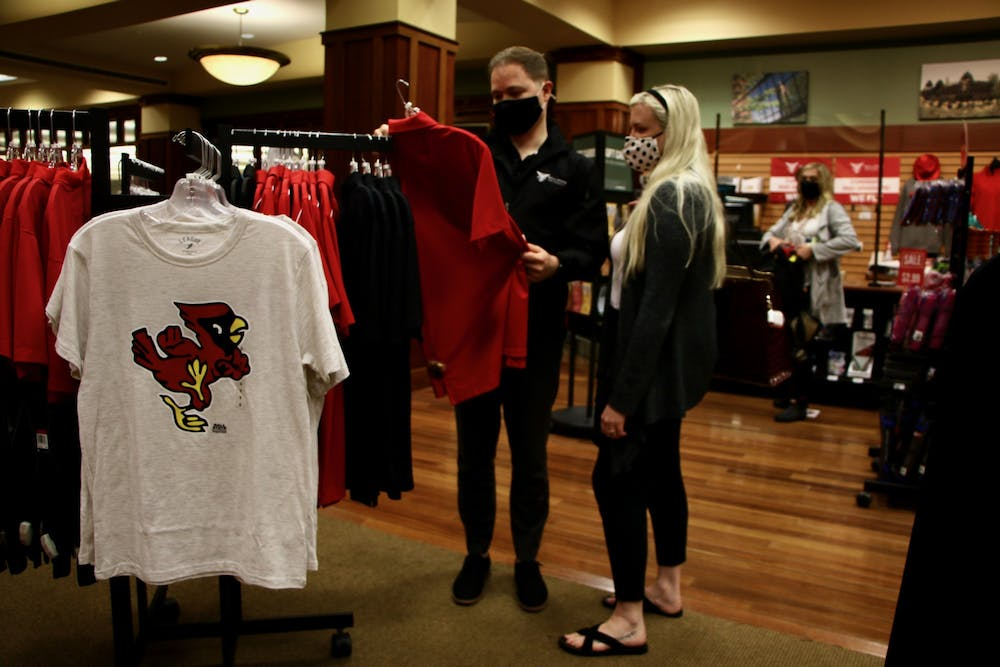 <p>Ty Garrison and Haylie McCracken, 2015 Ball State alumni, browse the bookstore in the Arts and Journalism Building June 2, 2021. Orientation guests eat in the Atrium during their lunch break and can buy university apparel in the bookstore. <strong>Grace McCormick, DN</strong></p>