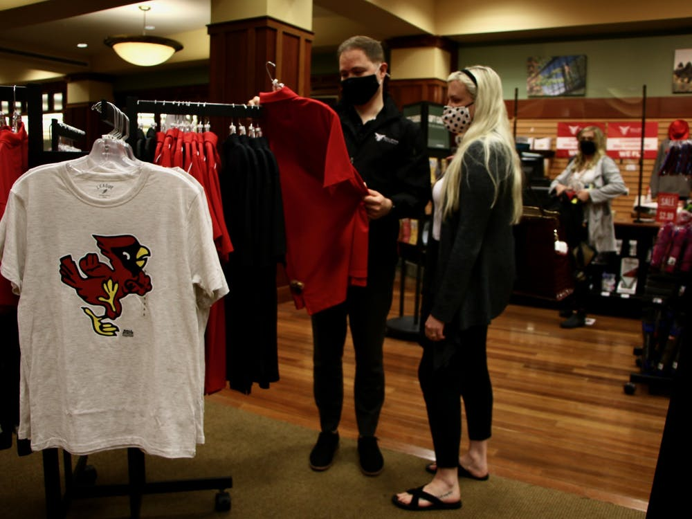 Ty Garrison and Haylie McCracken, 2015 Ball State alumni, browse the bookstore in the Arts and Journalism Building June 2, 2021. Orientation guests eat in the Atrium during their lunch break and can buy university apparel in the bookstore. Grace McCormick, DN
