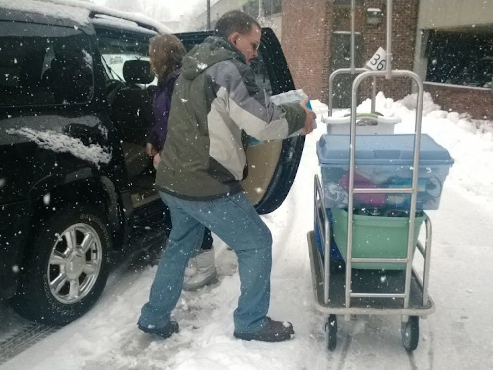 Junior Kylie Pine and her father Bob Elliott move in to Park during the snow. Pine and Elliott didn't encounter much difficulty on their way to Muncie from the south side of Indianapolis.