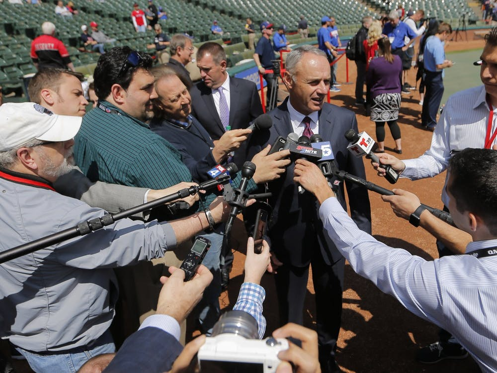 Rob Manfred, commissioner of Major League Baseball, talks with reporters as the Houston Astros play the Texas Rangers on opening day of Major League Baseball at Globe Life Park Thursday, March 29, 2018 in Arlington, Texas. (Rodger Mallison/Fort Worth Star-Telegram/TNS)