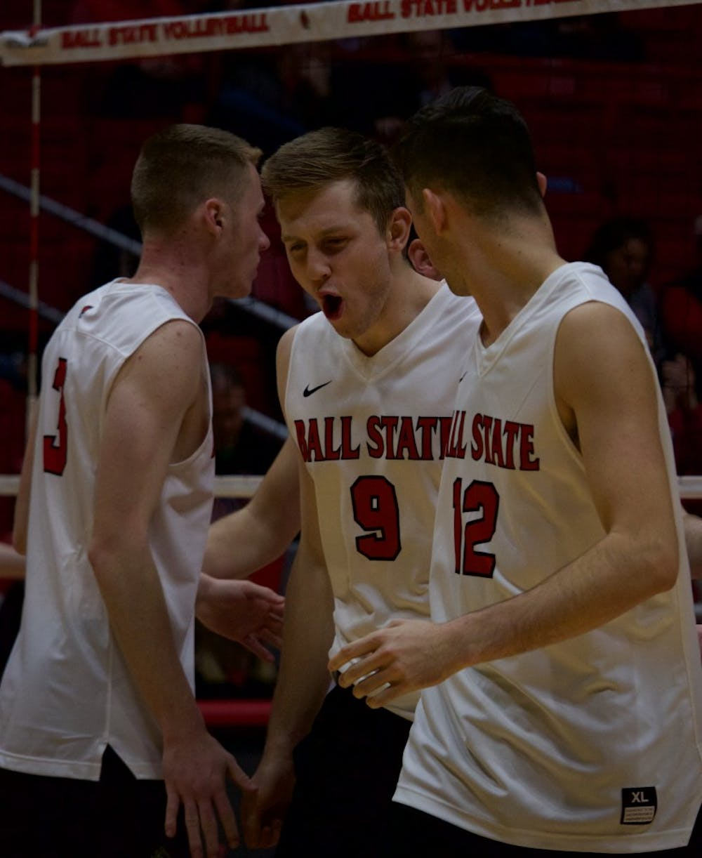 <p>Junior Parker Swartz cheers after winning a volley against Quincy in the second game on March 31 at John E. Worthen Arena. The Ball State Cardinals won all three games played. <strong>Rebecca Slezak, DN</strong></p>