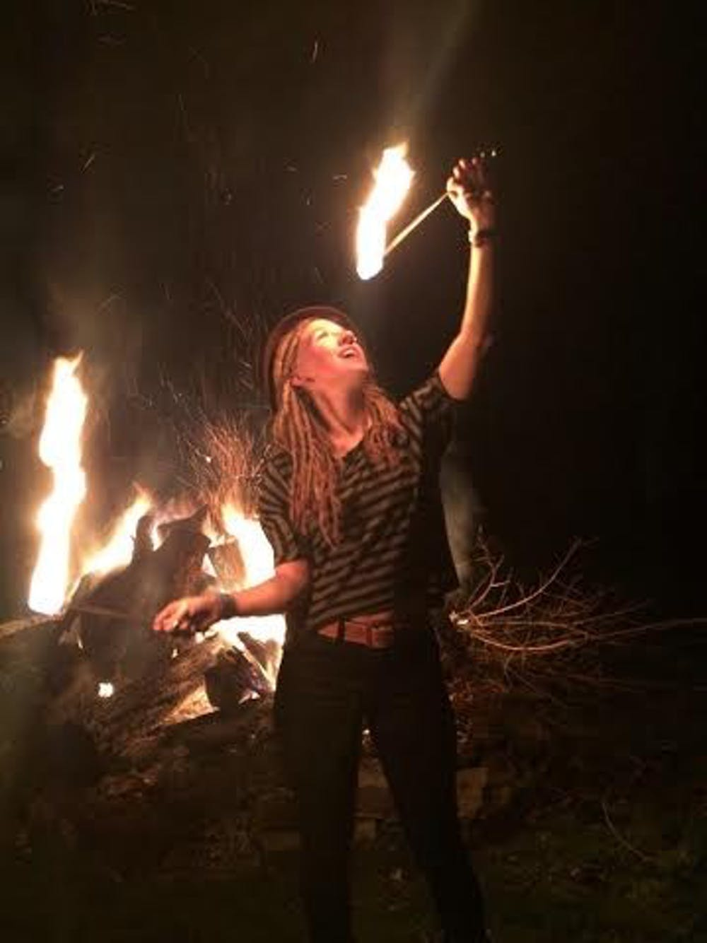"<p>Alumna Kelzie Jo Selch prepares to ""eat"" fire. Selch and other flow artists perform on Mondays at Be Here Now. <em>PHOTO PROVIDED BY KELZIE JO SELCH</em></p>"
