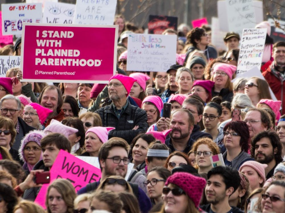 An estimated 4,500 to 5,000 people gathered outside the Indiana Statehouse on Jan. 21 for the Indianapolis Women's March, according to Indiana State Police. The rally was held in conjunction with hundreds of marches nationwide to support women's rights and protest the presidency of Donald Trump. Grace Ramey // DN