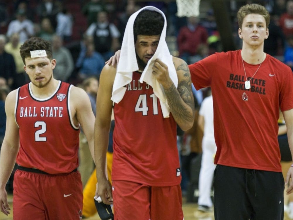 Sophomore guard Tayler Persons, sophomore center Trey Moses and freshman forward Zach Hollywood walk off the court after the MAC semifinal game against Akron on March 10 at Quicken Loans Arena in Cleveland, Ohio. Ball State lost the competition 74-70. Breanna Daugherty, DN File