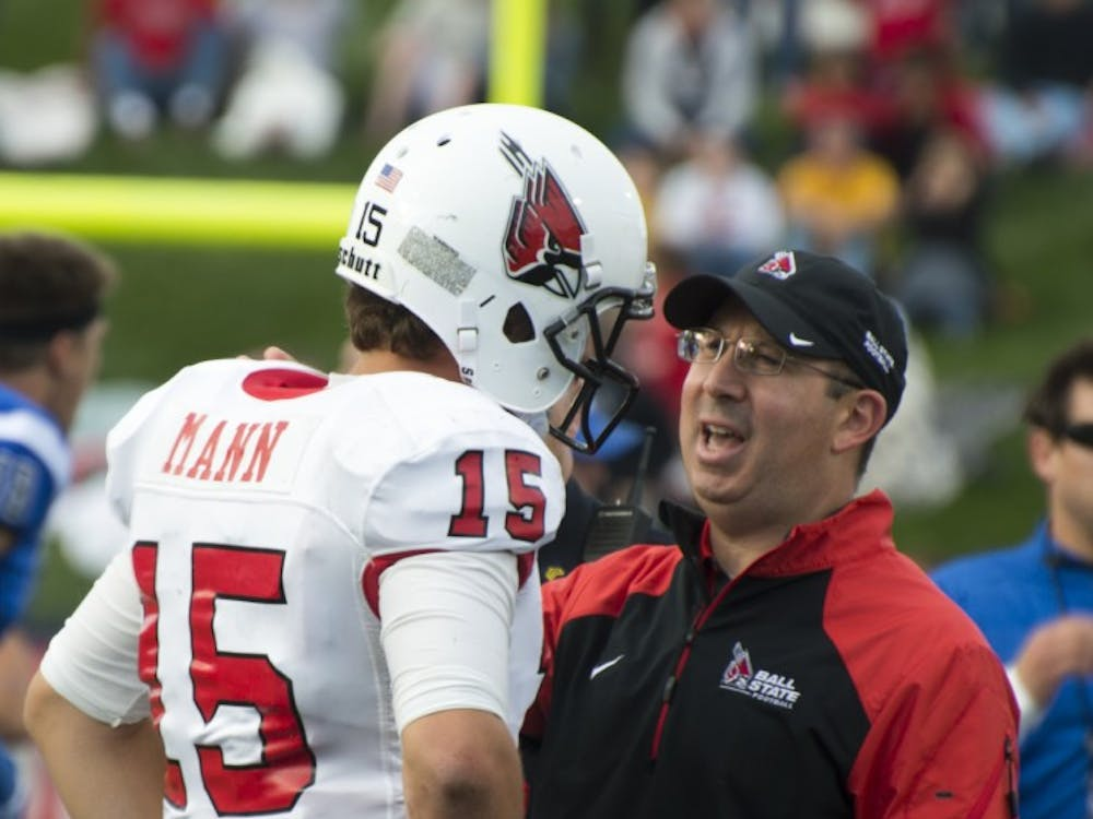Head coach Pete Lembo talks to redshirt sophomore Ozzie Mann after the football game against Indiana State on Sept. 13 at Scheumann Stadium. DN PHOTO ALAINA JAYE HALSEY