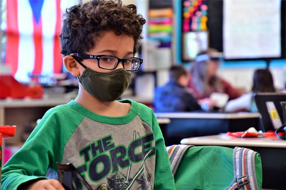 <p>Owen Roberts sits in class, April 16, 2021, in West View Elementary School. All schools in Muncie Community Schools (MCS) have changed their quarantine policies to allow students to continue coming to class if they are designated close contacts of classmates who have tested positive for COVID-19, as long as those close-contact students are not exhibiting symptoms of the virus. Masks are still required for all staff, faculty and students in MCS at this time. <strong>Andy Klotz, Photo Provided</strong></p>