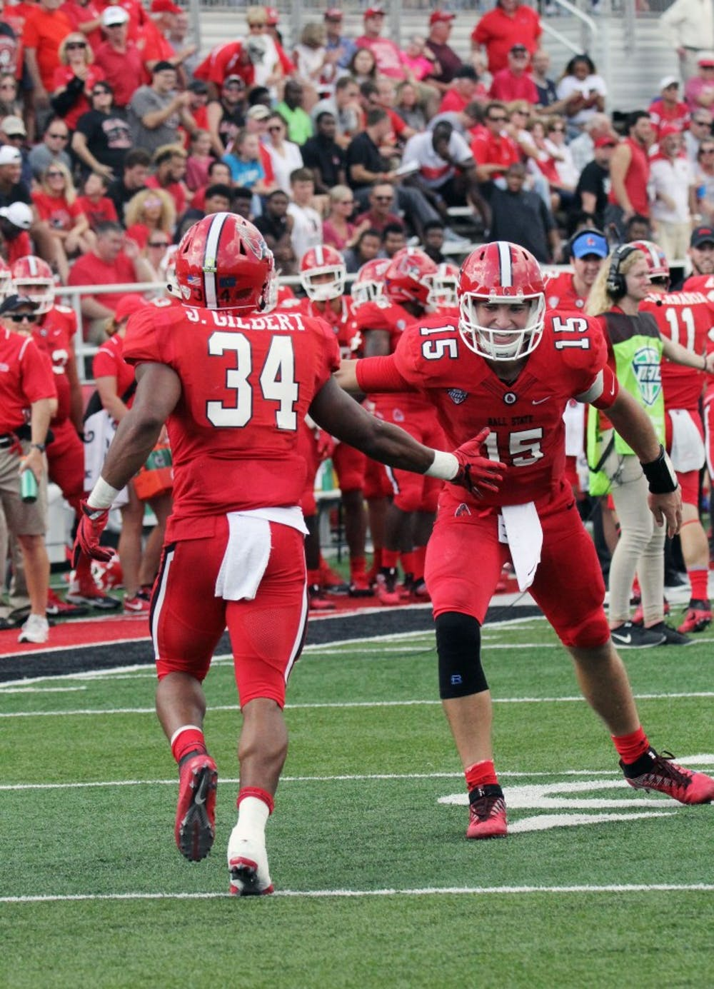Ball State junior running back James Gilbert high-fives junior quarterback Riley Neal after scoring a touchdown in the second quarter during the Cardinals' game against Tennessee Tech on Sept. 16 at Scheumann Stadium. Gilbert had 17 receiving yards. Paige Grider, DN