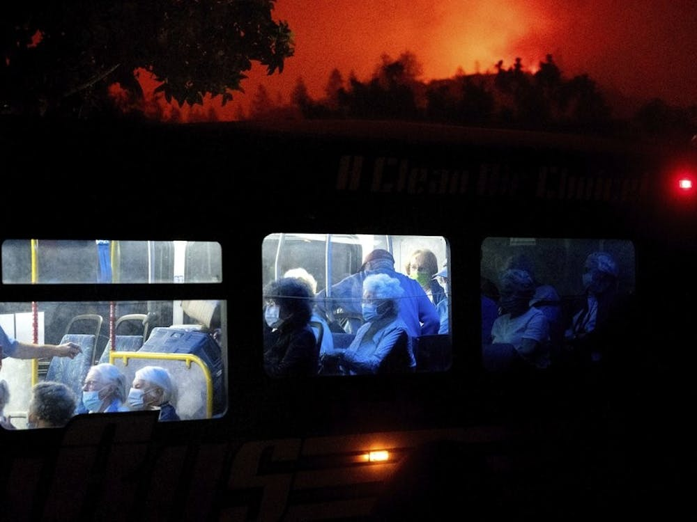 Residents of the Oakmont Gardens senior home evacuate on a bus as the Shady Fire approaches in Santa Rosa Calif., Monday, Sept. 28, 2020. (AP Photo/Noah Berger)