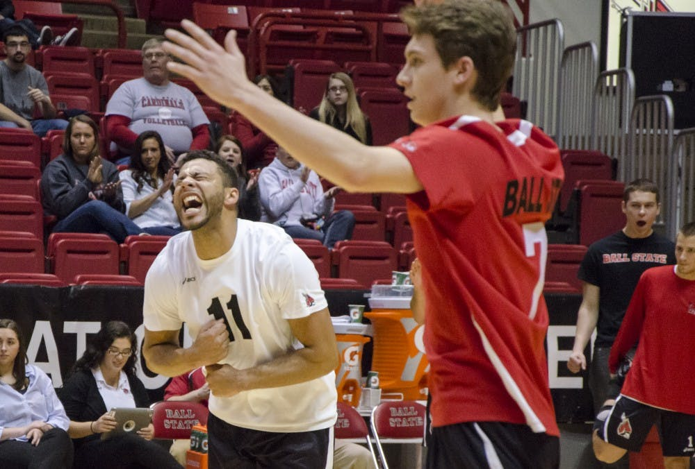 Outside attackers Larry Wrather and Shane Witmer celebrate a point for Ball State after a volley with Sacred Heart during the Jan. 11 match in Worthen Arena. DN PHOTO COREY OHLENKAMP