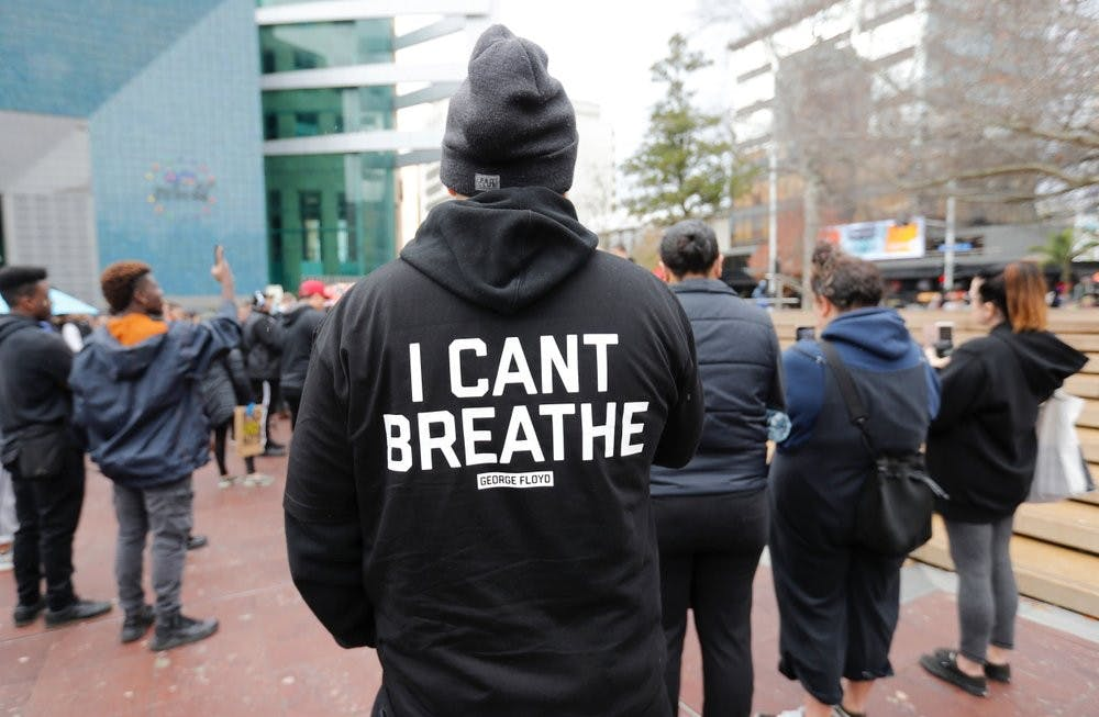 <p>A demonstrator stands during a march in central Auckland, New Zealand, June 1, 2020, to protest the death of United States' George Floyd, a black man who died in police custody in Minneapolis on May 25. Floyd, who after a white police officer who is now charged with murder, Derek Chauvin, pressed his knee into Floyd's neck for several minutes even after he stopped moving and pleading for air. <strong>(Dean Purcell/New Zealand Herald via AP)</strong></p>