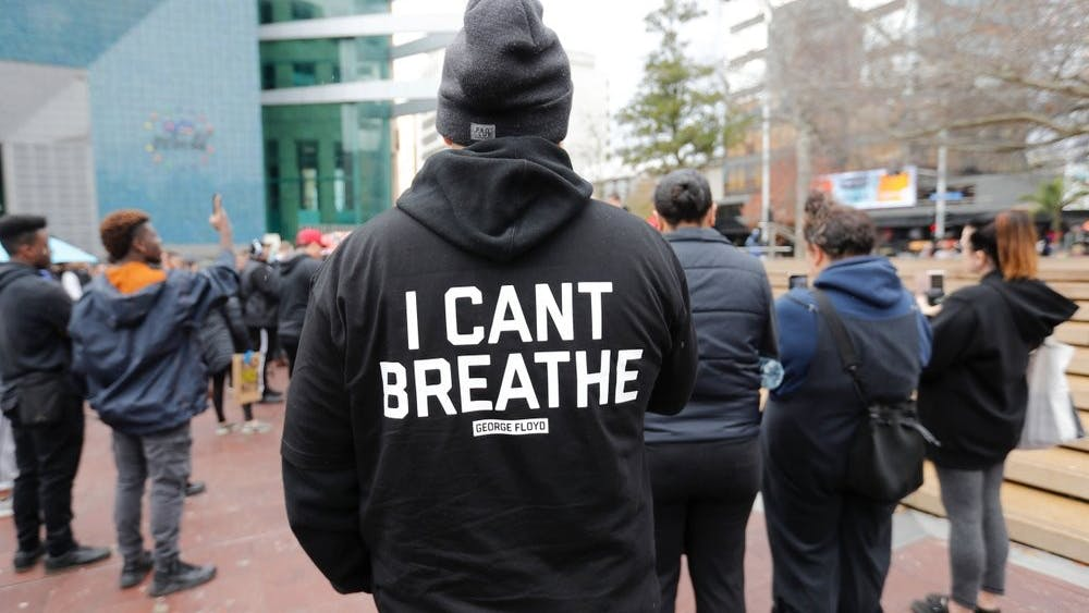 A demonstrator stands during a march in central Auckland, New Zealand, June 1, 2020, to protest the death of United States' George Floyd, a black man who died in police custody in Minneapolis on May 25. Floyd, who after a white police officer who is now charged with murder, Derek Chauvin, pressed his knee into Floyd's neck for several minutes even after he stopped moving and pleading for air. (Dean Purcell/New Zealand Herald via AP)