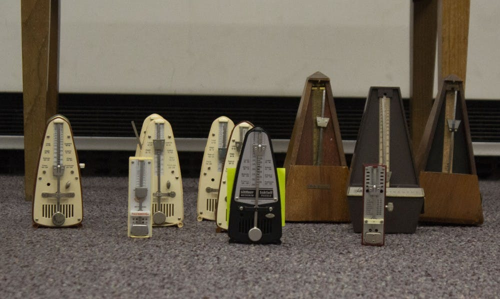 """<p>Amelia Kaplan, associate professor of music composition, is tracking down 100 metronomes for a concert Dec. 6, 2018, in Sursa Performance Hall. The piece, """"Poéme Symphonique,"""" utilizes 100 mechanical metronomes in a single musical composition. <strong>Patrick Murphy, DN</strong></p>"""