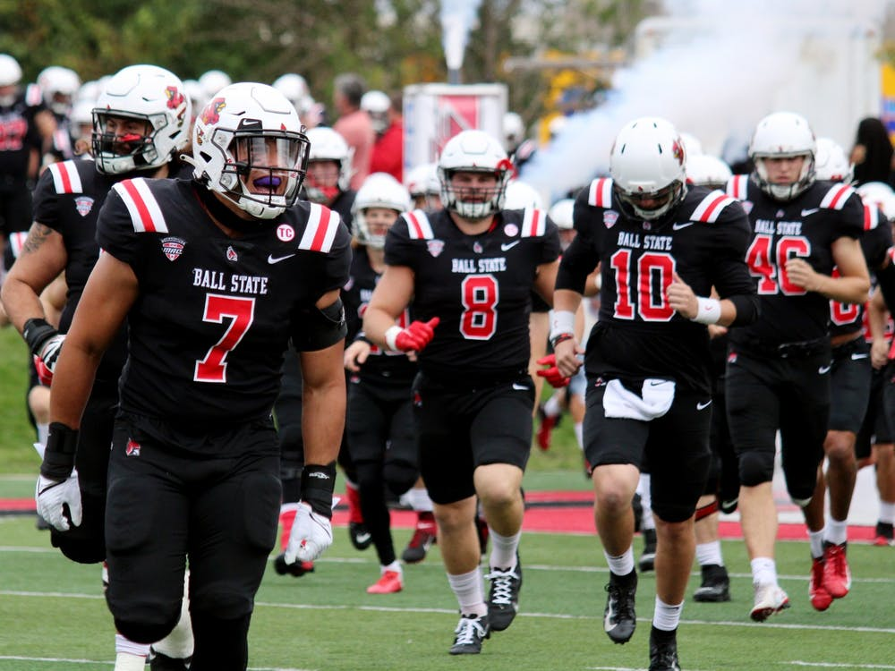Inside linebacker redshirt senior Brandon Martin (7) runs out onto the field for the Homecoming game against Miami Ohio on Oct. 23, 2021, at Scheumann Stadium in Muncie, IN. Amber Pietz, DN