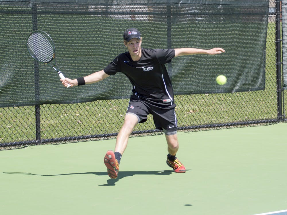 Sophomore Lucas Anderson hits the ball during the match against Western Michigan on April 11 at Cardinal Creek Tennis Courts. DN PHOTO ALAINA JAYE HALSEY