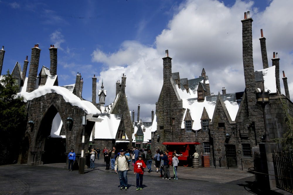 Visitors stroll through Hogsmeade village at the Wizarding World of Harry Potter at Universal Studios Hollywood on March 7, 2016. (Mark Boster/Los Angeles Times/TNS)
