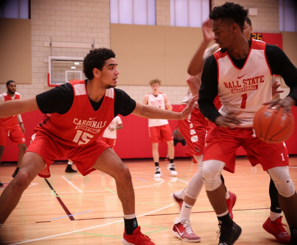 <p>Sophomore forward Zach Gunn defends redshirt junior guard K.J. Walton during a practice at Dr. Don Schondell Practice Center on Nov 29, 2018. <strong>Jack Williams,DN</strong></p>