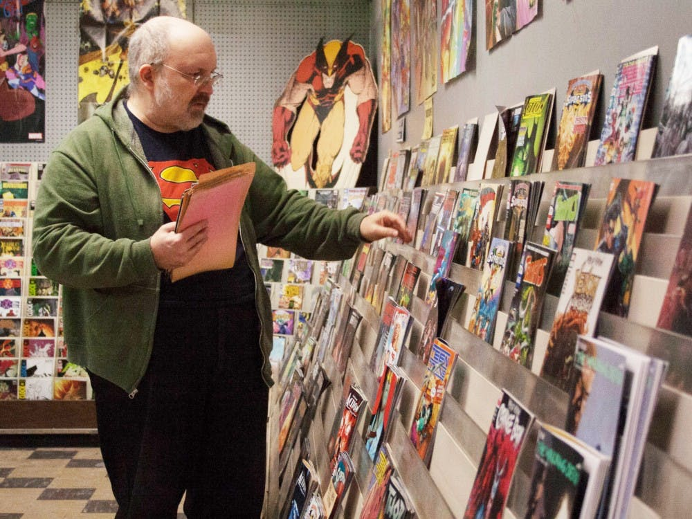 Trent Reeder, owner of Bob's Comic Castle prepares for the day by putting out new comics Jan. 16, 2019, in Muncie, Indiana. Reeder originally opened Bob's Comic Castle with his former business partner, Bob Ford. Jack Hart, DN