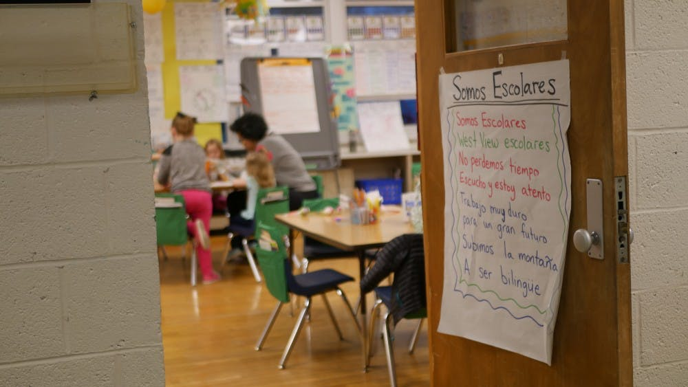 <p>A sign is displayed on the door of a classroom where West View Elementary School students gather while their parents attend the informational session about the Dual Language immersion program Feb. 28, 2019. Students learn English alongside Spanish from as early as kindergarten. <strong>Jake Helman, DN</strong></p>