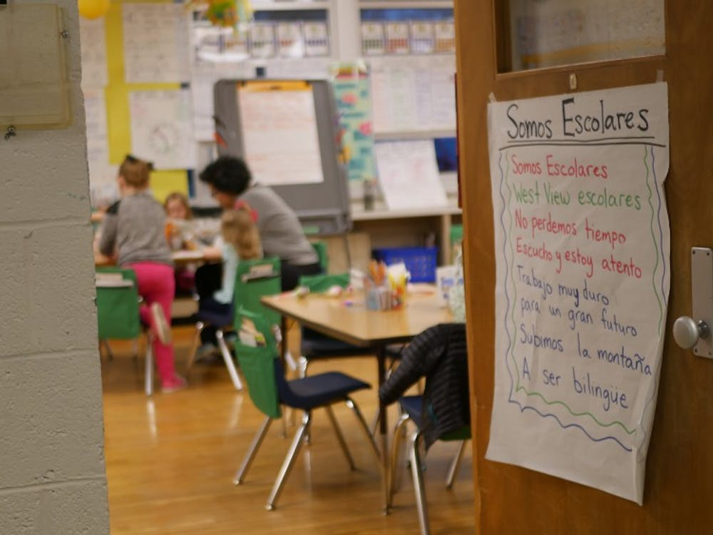 A sign is displayed on the door of a classroom where West View Elementary School students gather while their parents attend the informational session about the Dual Language immersion program Feb. 28, 2019. Students learn English alongside Spanish from as early as kindergarten. Jake Helman, DN