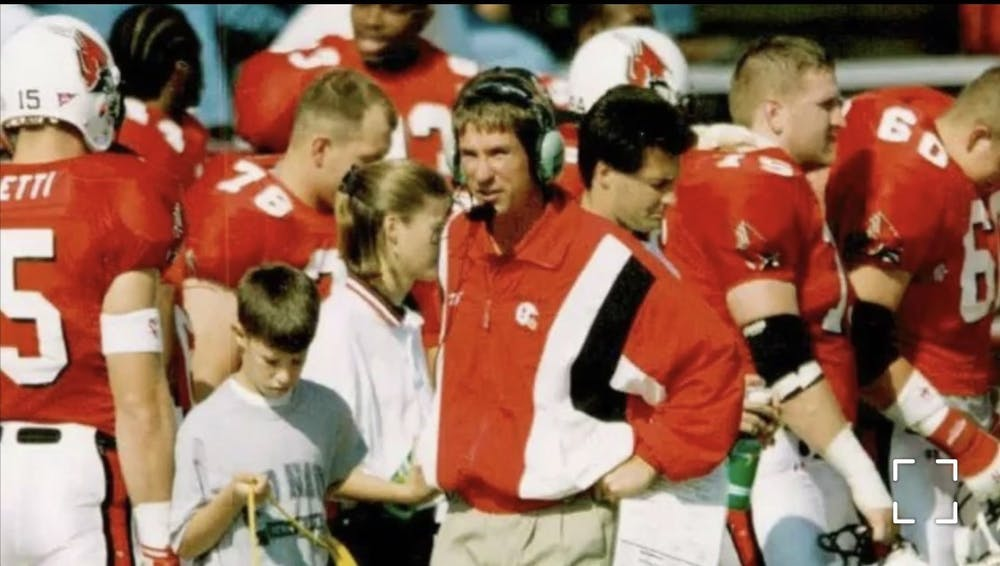 <p>Now-Ball State offensive coordinator Kevin Lynch assists his father, Bill, in carrying cords on the Scheumann Stadium sidelines. Bill Lynch became the Cardinals&#x27; offensive coordinator in 1990 —a position Kevin now holds. <strong>Kelly Manor, photo provided. </strong></p>