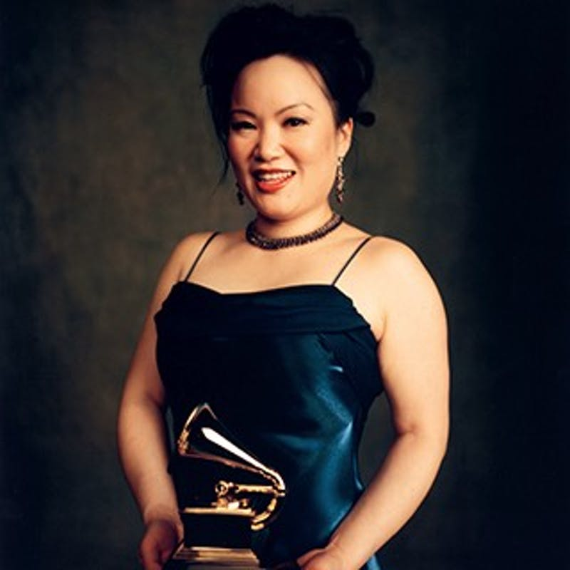 """Anglelin Chang holds her 2007 Grammy Award for her recording of Oliver Messiaen's """"Oiseaux Exotiques"""" with the Cleveland Chamber Symphony. Chang will perform at 2 p.m. Dec. 9 in Emens Auditorium. Ball State, Photo Provided."""