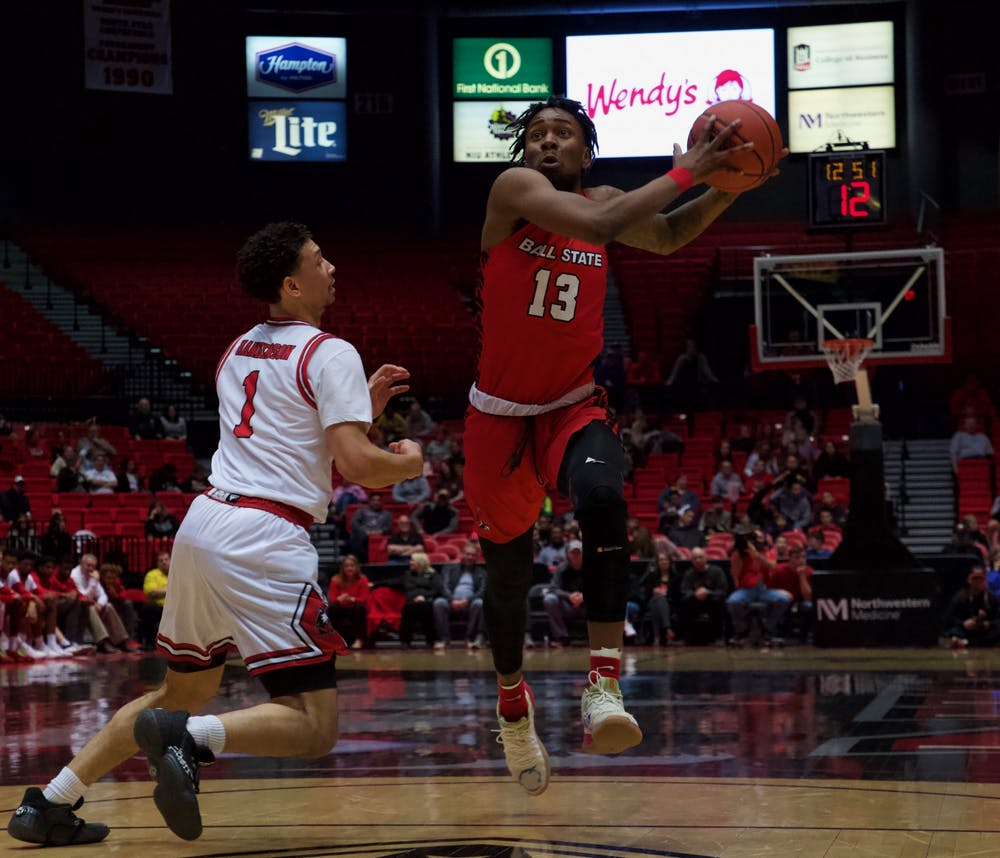 Redshirt freshman guard Kani Acree prepares to drive for a basket in a game against Northern Illinois on March 6 at the Convocation Center. The Cardinals defeated the Huskies 75-54. Jack Williams, DN