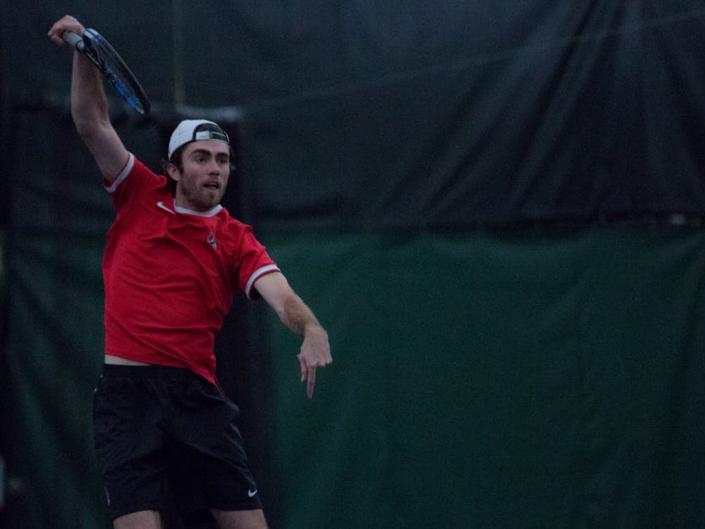 Junior Tom Carney returns a ball in a doubles match against the University of Toledo. Ball State won 5 to 2 on March 24 at Northwest YMCA in Muncie. Eric Pritchett, DN