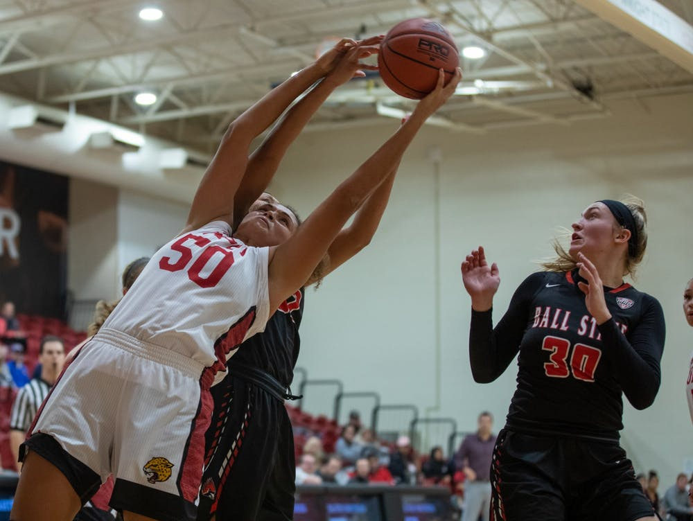 Sophomore Forward/ Center Macee Williams jumps for the ball against the Cardinals' Nov. 5, 2019, in the IUPUI Gymnasium in Indianapolis, Ind. Williams scored 15 points against the Cardinals. Jacob Musselman, DN