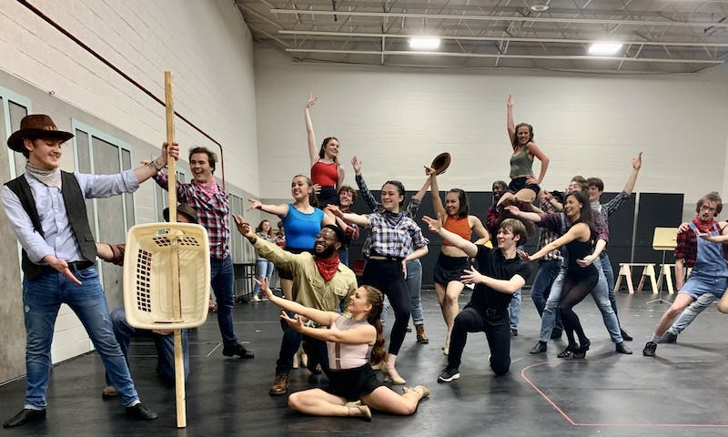 "The cast of ""Crazy For You"" end a dance number in their final rehearsal on March 12 in the Korsgaard Dance Studio. Because props were not completed, the actors gesture toward a laundry basket representing a string bass. Sarah Jenkins, Photo Provided"