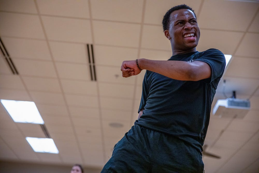 <p>Immanuel Simon dances during his class Feb. 13, 2020, at the Jo Ann Gora Student Recreation and Wellness Center. Simon likes to move around the dance room during his class, walking in between his students. <strong>Jacob Musselman, DN</strong></p>