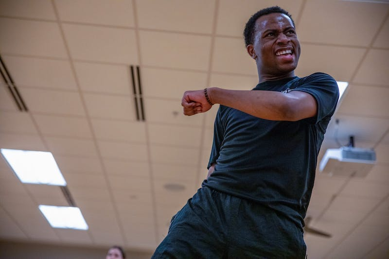 Immanuel Simon dances during his class Feb. 13, 2020, at the Jo Ann Gora Student Recreation and Wellness Center. Simon likes to move around the dance room during his class, walking in between his students. Jacob Musselman, DN