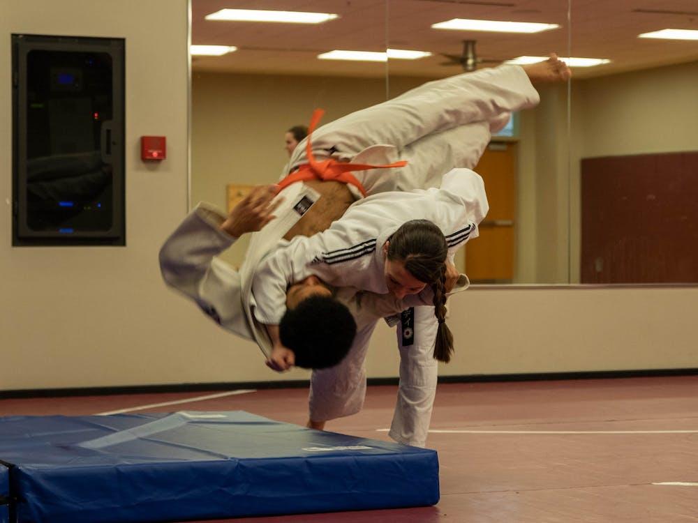 Sensei Wendy Koslicki practices throws David Mitchell during judo practice Feb. 22, 2020, in the Jo Ann Gora Recreation and Wellness Center. Koslicki started judo 19 years ago. Jaden Whiteman, DN